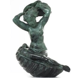 Venus seated on a shell