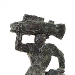 Triton bärande fisk på huvudet (I)